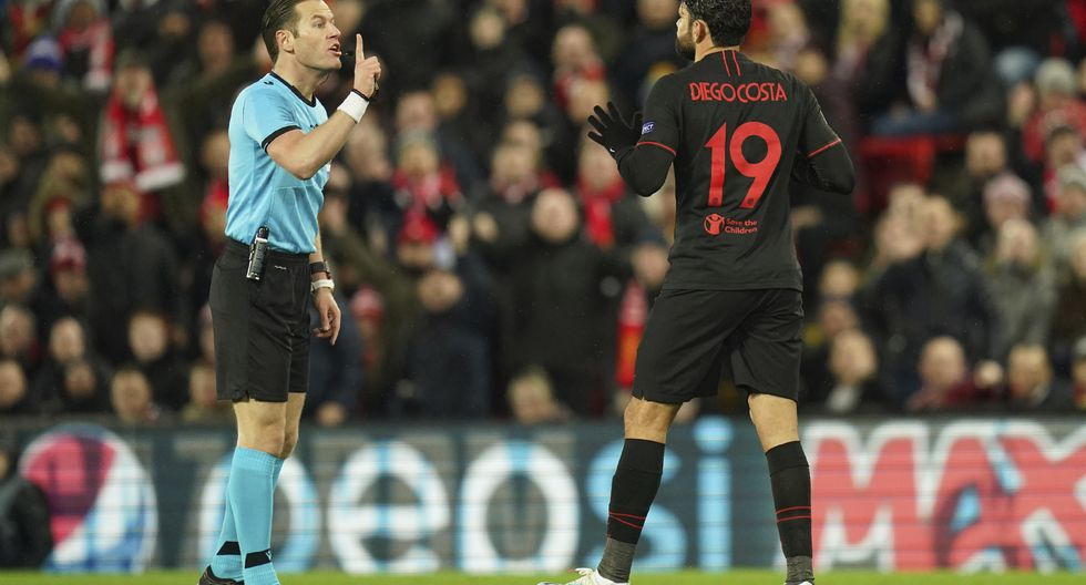 Referee Danny Makkelie, left, argues with Atletico Madrid's Diego Costa during a second leg, round of 16, Champions League soccer match between Liverpool and Atletico Madrid at Anfield stadium in Liverpool, England, Wednesday, March 11, 2020. (AP Photo/Jon Super)