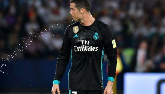 """Cristiano Ronaldo y su reacción tras oír: """"Messi, Messi, Messi"""". (Foto: AFP)"""