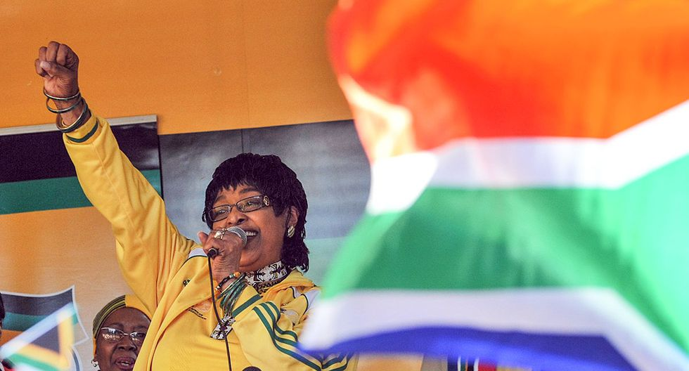 (FILES) In this file photo taken on June 04, 2010 South African MP Winnie Madikizela-Mandela addresses members of  South Africa's ruling party African National Congress (ANC) during  a street party to celebrate six days left to the opening of the 2010 Fifa World Cup in Johannesburg .  Winnie Mandela, the ex-wife of South African anti-apartheid fighter and former president Nelson Mandela, died on Monday at the age of 81, her spokesman said. She died in a Johannesburg hospital after a long illness, spokesman Victor Dlamini said in a statement. 