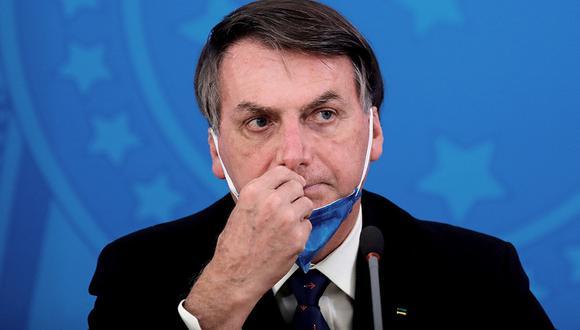El uso de mascarillas es recomendado por autoridades y expertos en salud como una forma de reducir la transmisibilidad del coronavirus COVID-19. Sin embargo, el presidente Jair Bolsonaro ha desestimado su uso en varias ocasiones. (Foto: AFP)