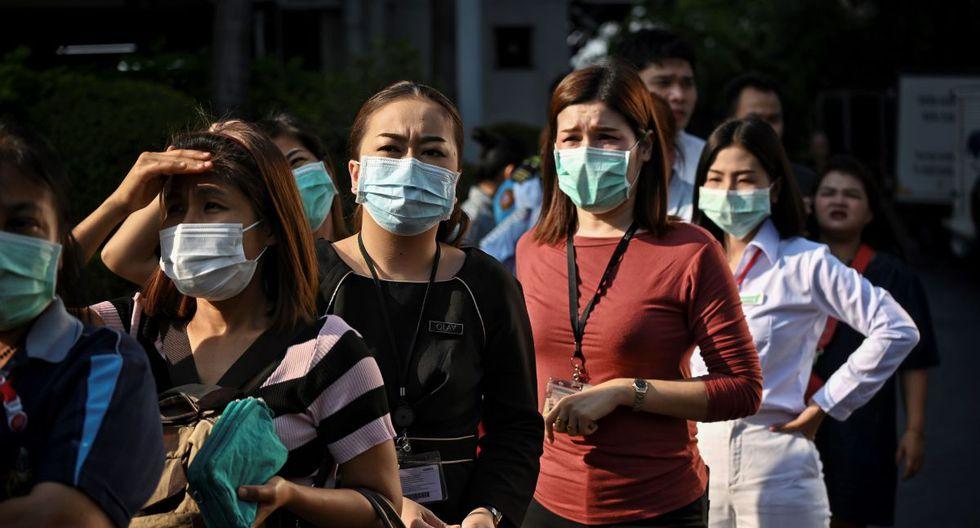 """""""Diario de la peste"""" es una columna que muestra la perspectiva del autor portugués Gonçalo Tavares en los tiempos del coronavirus. Fotografía tomada en Tailandia, país donde se ha incrementado exponencialmente el uso de mascarillas. (Foto: Lillian SUWANRUMPHA / AFP)"""