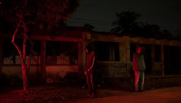 Miembros de la Casa Blanca en San Pedro Sula, Honduras, una ciudad dividida por las pandillas y los estallidos de violencia. (Tyler Hicks/The New York Times).