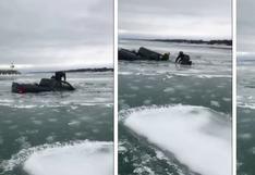 El emocionante rescate de un conductor poco antes de que su camioneta se hunda en río congelado