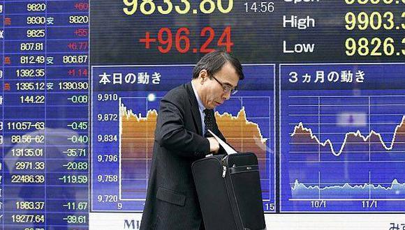 Japón defiende criticada política de tasa de interés negativa