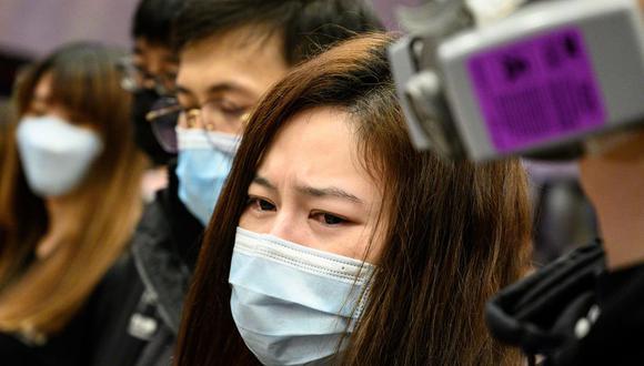 China cerró las puertas de varias de sus ciudades y prohibió los viajes organizados de sus ciudadanos. (Foto: AFP)
