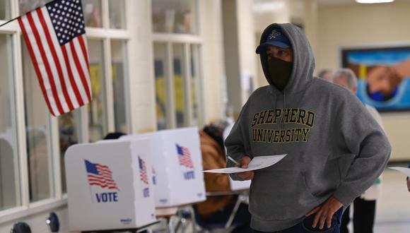 Elecciones USA: Los votantes sufragan en un colegio electoral en Winchester, Virginia. (Foto de ANDREW CABALLERO-REYNOLDS / AFP).