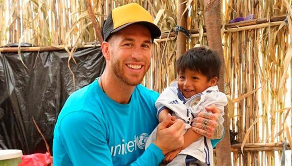 Sergio Ramos junto a Josué, el niño piurano con el que compartió momentos en su visita al Perú en el 2017. (Foto: UNICEF)