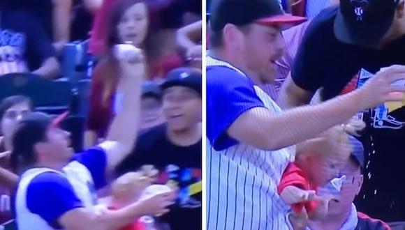 La rápida reacción de este padre le permitió atrapar una pelota de Baseball, cuidar a su bebé y no dejar caer su vaso de cerveza (Foto: Twitter)