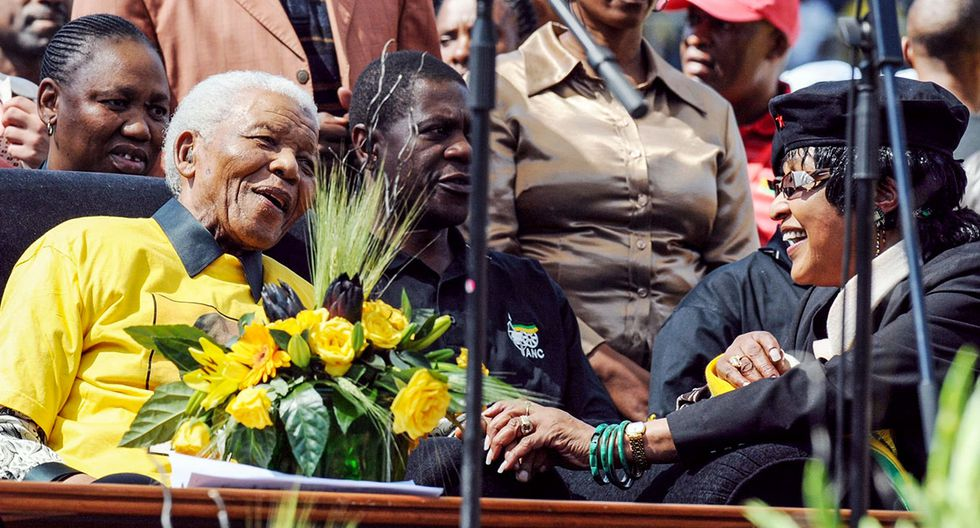 (FILES) In this file photo taken on April 19, 2009, former South African President Nelson Mandela (L) is greeted by his former wife Winnie Madikizela-Mandela (R) in Johannesburg at Ellis Park stadium during the final African  National Congress presiential election rally.  Winnie Mandela, the ex-wife of South African anti-apartheid fighter and former president Nelson Mandela, died on April 2, 2018 in a Johannesburg hospital after a long illness at the age of 81, her spokesman Victor Dlamini said in a statement. / AFP / ALEXANDER JOE