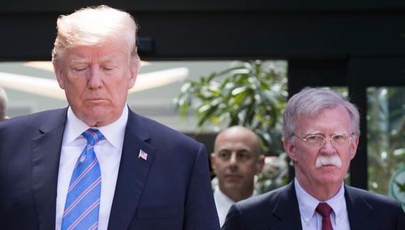 El presidente de los Estados Unidos, Donald Trump, con el exasesor de seguridad nacional John Bolton (derecha) durante la cumbre del G7 en La Malbaie. (Foto: Archivo / Lars Hagberg / AFP).