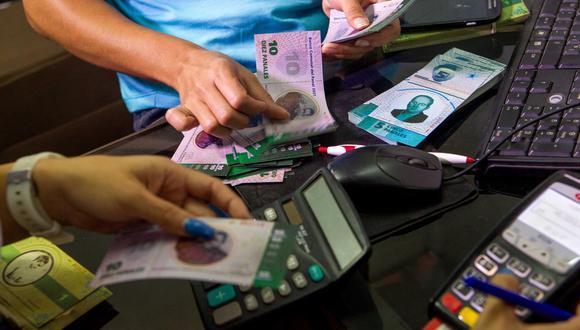 Averigua el precio de dólar en Venezuela que abre a la baja este viernes 7 de agosto. (Foto: Cristian Hernandez / EFE)