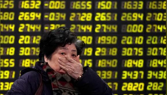 Una inversionista reacciona frente a un tablero electrónico de una correduría en Shanghái. 9 de febrero 2018. Fotod:(Reuters/Aly Song)
