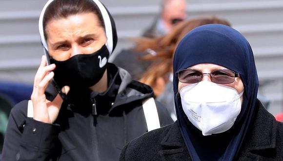 Según experto, las mascarillas podrían dejar de ser obligatorias este mismo año. (Foto: EFE/ Fehim Demir)