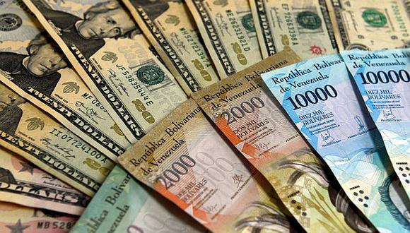 Averigua el precio de dólar en Venezuela mientras los casos de COVID-19 aumenta en el país. (Foto: AFP)