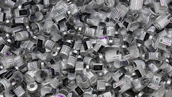 Empty vials of vaccines by Pfizer-BioNTech and AstraZeneca against Covid-19 caused by the novel coronavirus are pictured at the vaccination center in Rosenheim, southern Germany, on April 20, 2021, amid the novel coronavirus / COVID-19 pandemic. (Photo by Christof STACHE / AFP)
