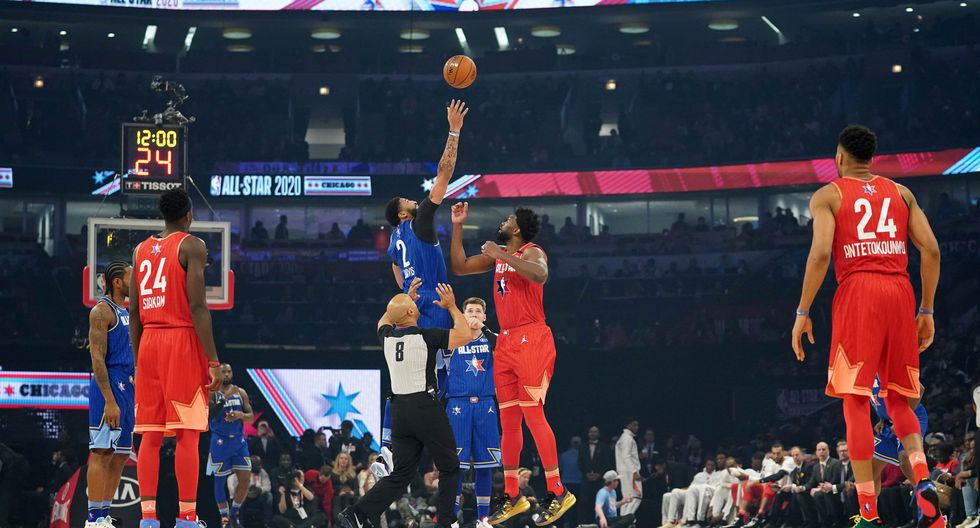 Feb 16, 2020; Chicago, Illinois, USA; Team Giannis center Joel Embiid of the Philadelphia 76ers and Team LeBron forward Anthony Davis of the Los Angeles Lakers go up for the opening tip in the first quarter during the 2020 NBA All Star Game at United Center. Mandatory Credit: Kyle Terada-USA TODAY Sports