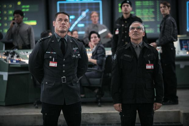 Left to right: John Cena as Agent Burns and John Ortiz as Dr. Powell in BUMBLEBEE, from Paramount Pictures.