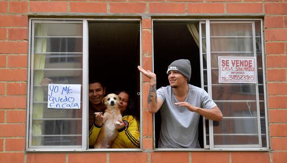 El 'pico y género' es una medida para evitar las aglomeraciones en Bogotá, que está en cuarentena por el coronavirus.  (AFP / Raul ARBOLEDA).