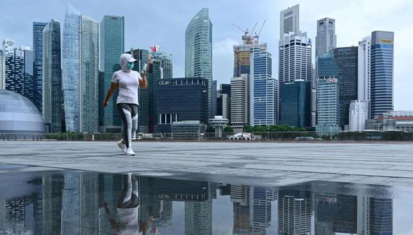 Las medidas adoptadas desde los primeros reportes del Covid-19 en China y la vacunación de un quinto de su población han puesto a Singapur como el país que mejor ha gestionado la pandemia en el mundo, según un ránking elaborado por la compañía Bloomberg. (Foto: Roslan Rahman / AFP)