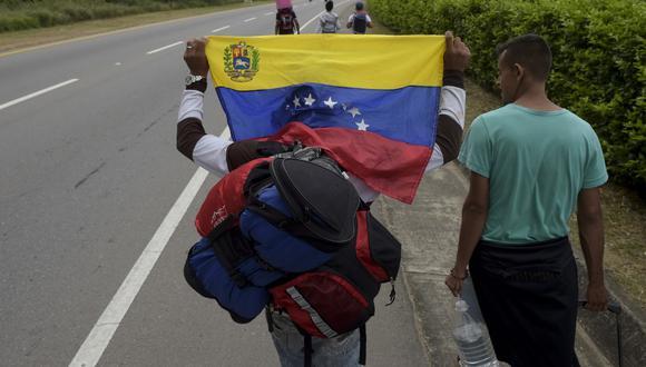 """La CIDH instó a Trinidad y Tobago a """"garantizar el ingreso"""" de """"personas venezolanas que buscan protección internacional por razones humanitarias urgentes, así como a respetar el principio de no devolución"""". (Raul ARBOLEDA / AFP)"""