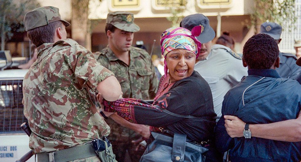 (FILES) In this file photo taken on May 22, 1991 Winnie Mandela (C), wife of deputy president of the ANC Nelson Mandela, was arrested for the second time today whilst staging a protest in downtown Johannesburg calling for the release of detainees on hunger strike.   Winnie Mandela, the ex-wife of South African anti-apartheid fighter and former president Nelson Mandela, died on April 2, 2018 in a Johannesburg hospital after a long illness at the age of 81, her spokesman Victor Dlamini said in a statement. / AFP / TREVOR SAMSON