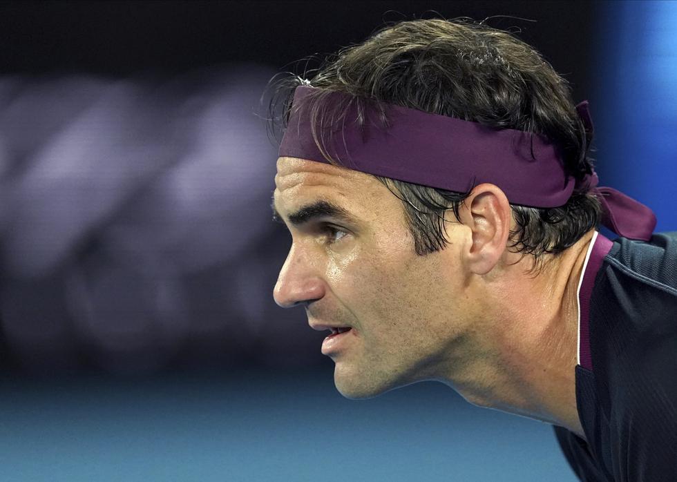 Estas son las mejores postales del duelo entre Roger Federer y Steve Johnson por el Abierto de Australia. (AP Photo/Lee Jin-man)