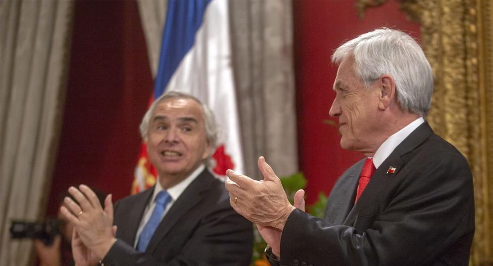 El presidente chileno, Sebastian Pinera, y el ex ministro de Interior y Seguridad Pública de Chile, Andrés Chadwick, juntos en la casa del gobierno en Santiago en octubre último. (AFP)