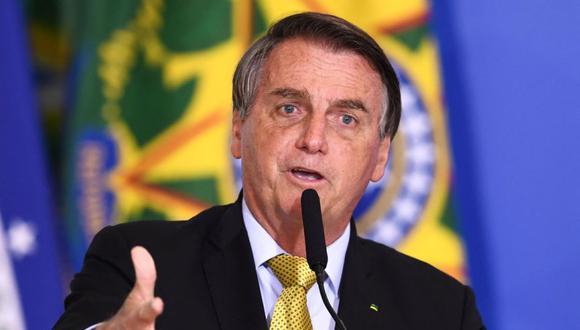 El presidente brasileño, Jair Bolsonaro, habla durante la ceremonia de inauguración de un nuevo registro de pescadores profesionales, en el Palacio Planalto de Brasilia. (Foto: AFP / EVARISTO SA).