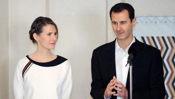 El presidente de Siria, Bashar al Asad, y su esposa Asma en una imagen del 2016. Ambos han dado positivo a coronavirus. (AFP).