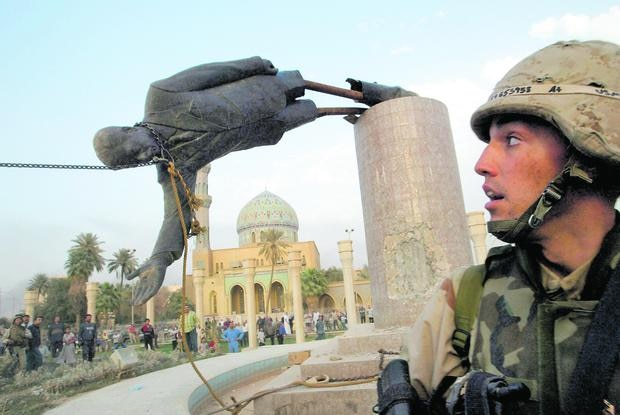 Following the 2003 invasion of Iraq, US troops quickly gained control of Baghdad.  In the photo, the statue of Saddam Hussein is demolished.  Selectors