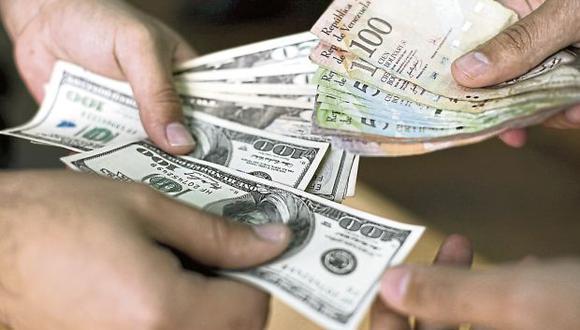 El dólar opera a la baja en las primeras horas de este viernes. (Foto: AFP)