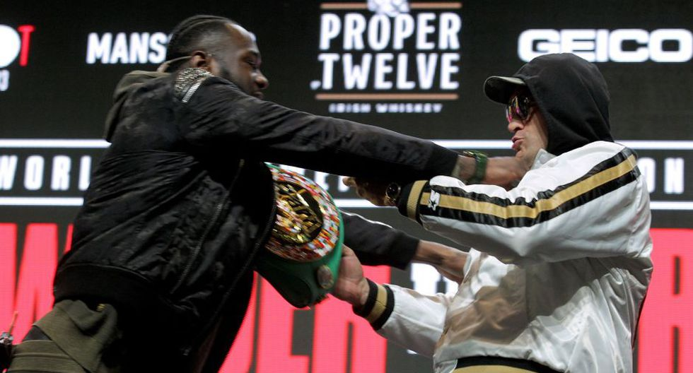 US boxer Deontay Wilder (L) and British boxer Tyson Fury get into an altercation during their press conference February 19, 2020 at the MGM Grand Las Vegas in Las Vegas, Nevada.  The boxers will fight for the World Boxing Council (WBC) Heavyweight Championship Title on February 22, 2020 at the MGM Grand Garden Arena in Las Vegas.  / AFP / John Gurzinski