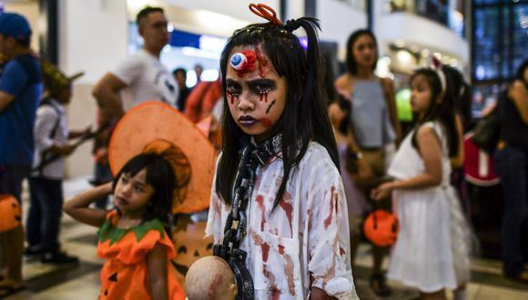 Debido a la pandemia del coronavirus, este año Halloween no se celebrará igual. (Foto: Mohd RASFAN / AFP)