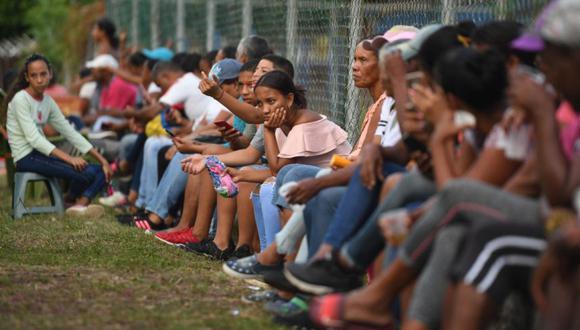 El pasado martes, las autoridades de Trinidad y Tobago informaron que un primer grupo de 124 venezolanos había sido repatriado a su país en un buque de la Armada venezolana. (Foto Referencial: Yuri CORTEZ / AFP)