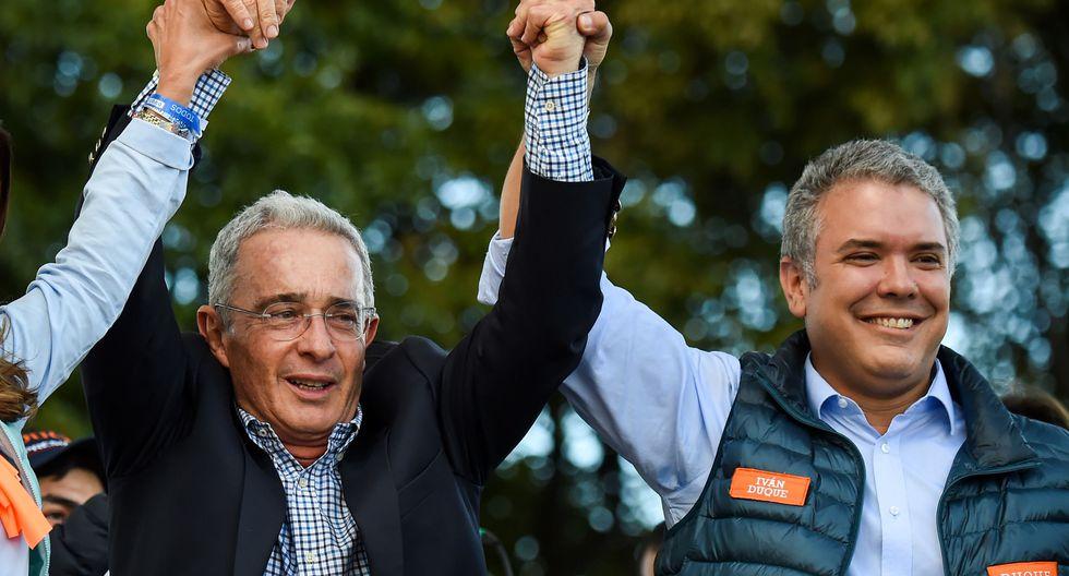 Álvaro Uribe junto a Iván Duque en una imagen del 20 de mayo del 2018. (Raúl ARBOLEDA / AFP).