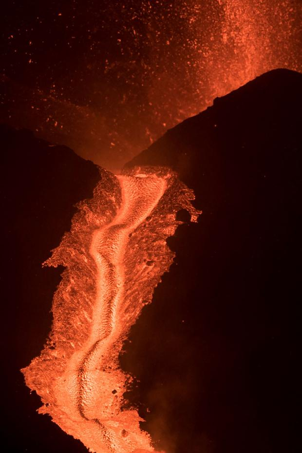 On the night of October 9, 2021, lava flows from the Cumbre Viza volcano overlooking the Los Lanos de Ariden on the island of La Palma Canary.