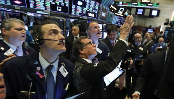 La caída de hoy en Wall Street ha coincidido también con la divulgación de los resultados trimestrales por parte de tres de los mayores grupos bancarios de EE.UU. (Foto: AP)