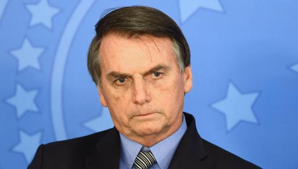Visiblemente furioso, Jair Bolsonaro acusó a la prensa de parcialidad contra él y su hijo, el senador Flávio Bolsonaro. (Foto: AFP/Archivo).