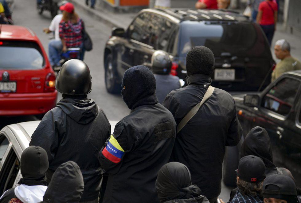 Colectivos chavistas participan en una marcha en favor de Nicolás Maduro en enero del 2019. (AFP).