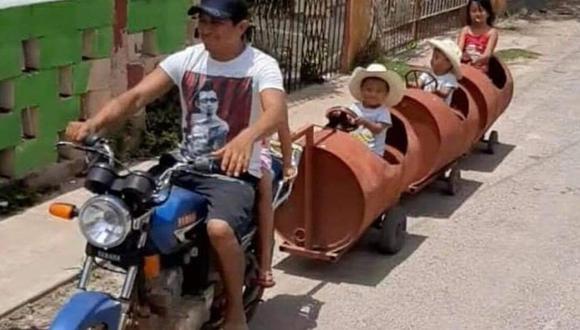 Un creativo padre utilizó barriles para construir un trencito con su moto y así pasear a sus hijos (Foto: Facebook / Voces del Paraíso)