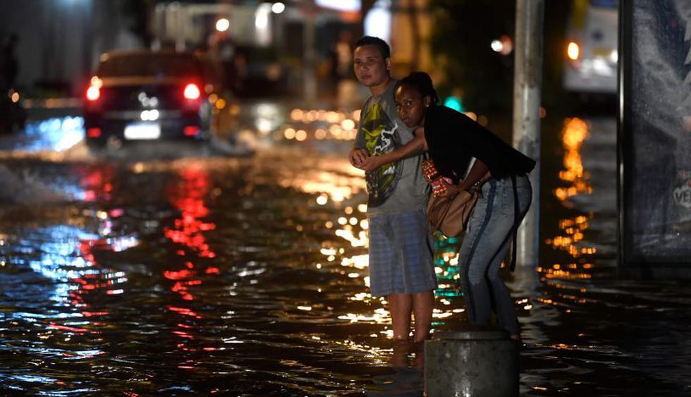 Varias calles que suben desde la playa de Botafogo sufrieron inundaciones, con árboles caídos y embotellamientos. (Foto: AFP)