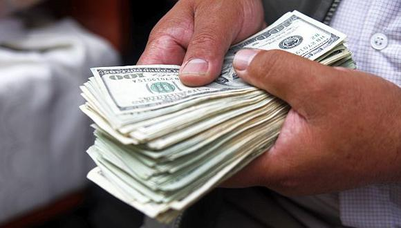 Dólar baja levemente luego de resultados de empleo en EE.UU.