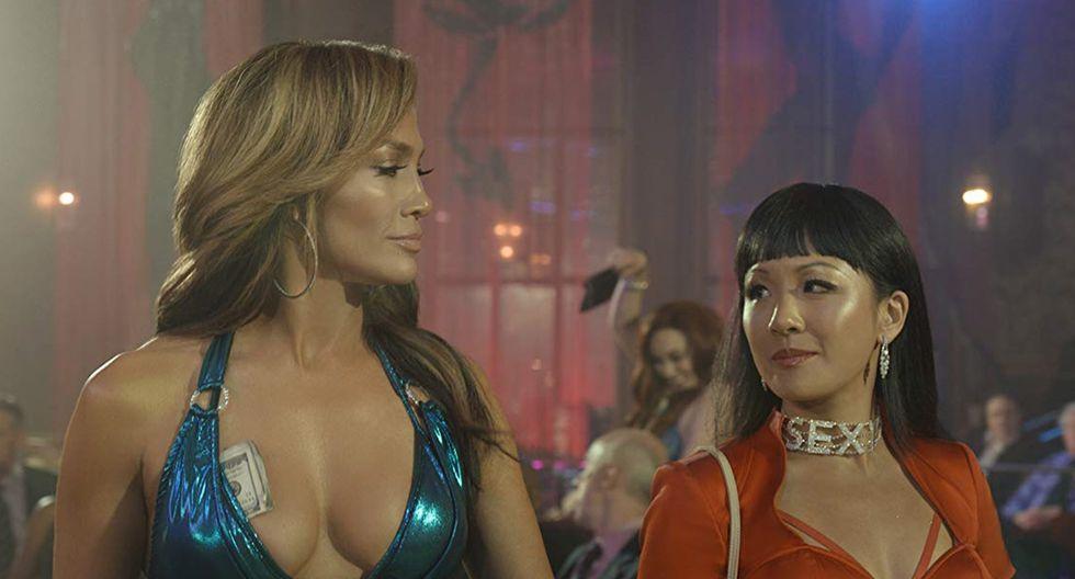 """Constance Wu (i) como Destiny y Jennifer López (d) como Ramona, durante una escena de la película """"Hustlers"""" que se estrena este 24 de octubre en Perú."""