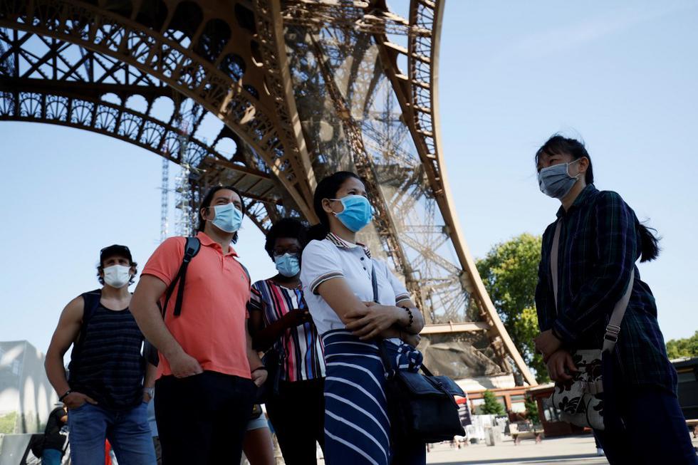 La Torre Eiffel, el monumento más famoso de París visitado anualmente por siete millones de personas, reabrió sus puertas este jueves, después de un cierre de tres meses debido a la pandemia del nuevo coronavirus. (Thomas SAMSON / AFP)