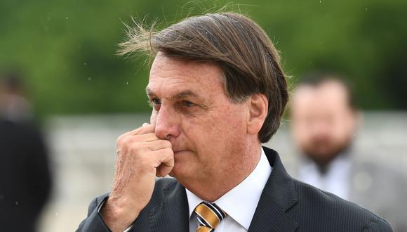El número de ministros brasileños en contraer la enfermedad representa el 61% de los 23 miembros del Gabinete de Jair Bolsonaro, líder de la negacionista ultraderecha brasileña y uno de los gobernantes más escépticos sobre la gravedad del nuevo coronavirus. (Foto: EVARISTO SA / AFP).