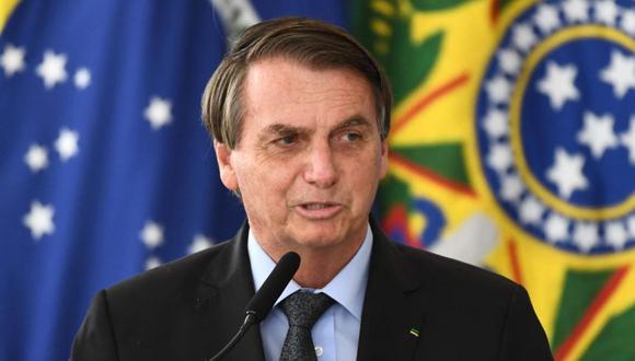 El presidente brasileño, Jair Bolsonaro, pronuncia un discurso durante el lanzamiento del Programa de Aguas Brasileñas en celebración del Día Internacional del Agua en el Palacio Planalto de Brasilia. (Foto: Archivo / AFP / EVARISTO SA).