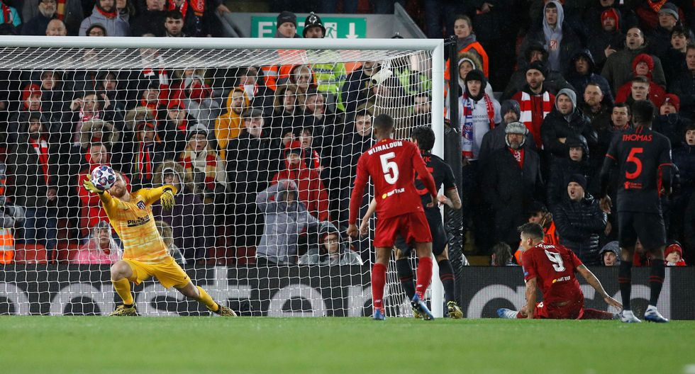 Soccer Football - Champions League - Round of 16 Second Leg - Liverpool v Atletico Madrid - Anfield, Liverpool, Britain - March 11, 2020  Atletico Madrid's Jan Oblak makes a save from Liverpool's Roberto Firmino   REUTERS/Phil Noble