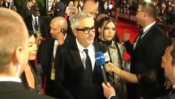 Alfonso Cuarón vivió incómodo momento a su paso por la alfombra roja de los Globos de Oro 2019, cuando efectivos de seguridad evitaron que ofrezca declaraciones a la prensa. (Foto: Captura de video)
