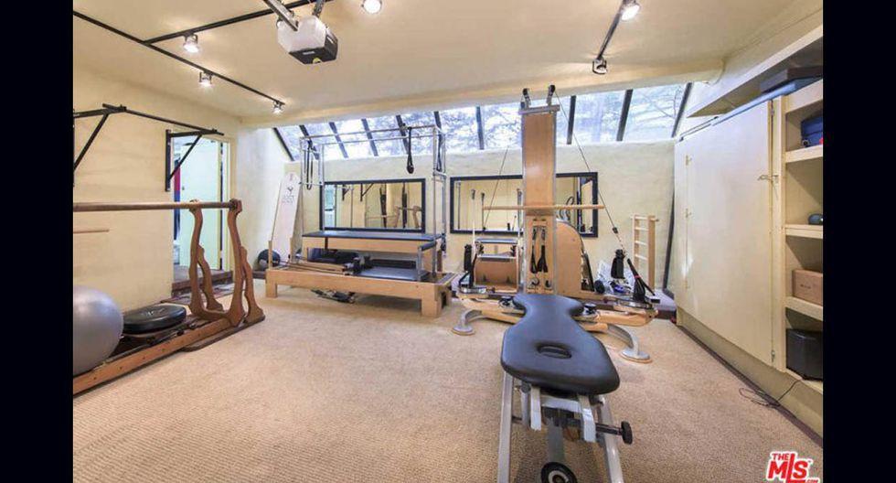 Un espacioso gimnasio todo equipado forma parte de los atractivos de la casa. (Foto: MLS / trulia.com)