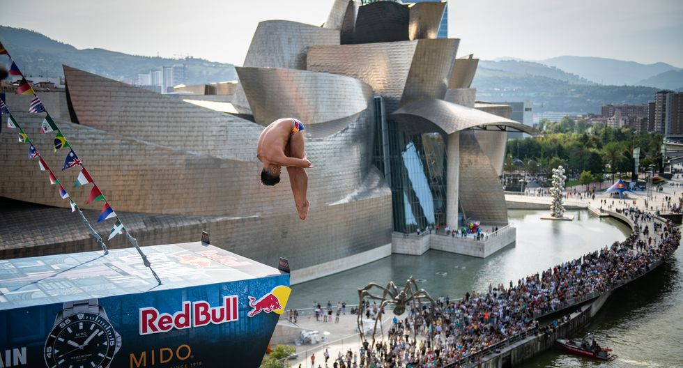 Jonathan Paredes of Mexico dives from the 27 metre platform during the first competition day of the seventh and final stop of the Red Bull Cliff Diving World Series in Bilbao, Spain on September 13, 2019. // Romina Amato/Red Bull Content Pool // AP-21JG3VU1H2111 // Usage for editorial use only //